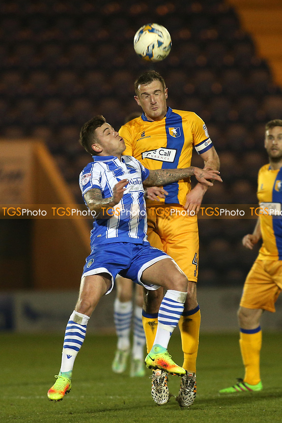 Sammie Szmodics of Colchester United and Lee Collins of Mansfield Town during Colchester United vs Mansfield Town, Sky Bet EFL League 2 Football at the Weston Homes Community Stadium on 14th March 2017