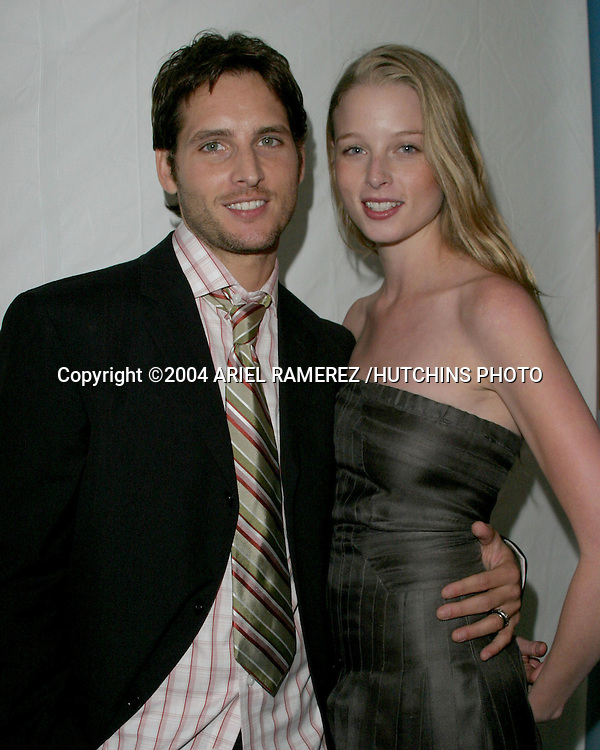 ©2004 ARIEL RAMEREZ/HUTCHINS PHOTO.FOX-TV UPFRONTS.CENTRAL PARK BOATHOUSE.NEW YORK CITY, NY.MAY 20, 2004..PETER AND RACHEL FACINELLI