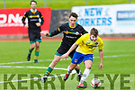 Classic FC's Cian O'Brien under pressure from Maurice O'Connor of Kilmoyley United in the Denny league on Sunday