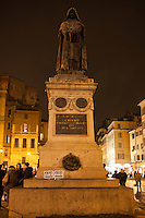 "A crowd gathered in Piazza Farnese in front of the French Embassy for a candlelight vigil in  solidarity with the victims of the attack against the headquarters of the satirical magazine Charlie Hebdo, which resulted in the killing of 12 in Paris. The event  has been promoted by the National Federation of the Italian Press (FNSI) and Articolo21. ""Je suis Charlie"" banners on the Giordano Bruno statue, martyr for free thought. Rome, Italy. Jan 8, 2015"
