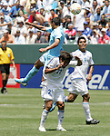 9 June 2007: El Salvador's Eliseo Quintanilla (21) ducks out of a challenge with an unidentified Guatemala player. The National Team of Guatemala defeated the National Team of El Salvador 1-0 at the Home Depot Center in Carson, California in a first round game in the CONCACAF Gold Cup.