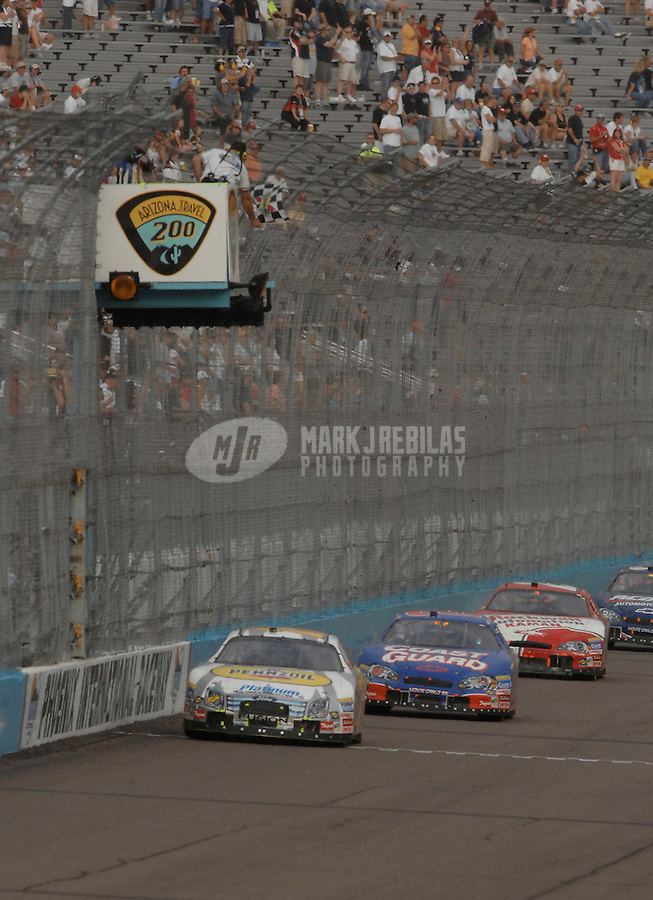 Nov. 11, 2006; Avondale, AZ, USA; Nascar Busch Series driver Matt Kenseth (17) takes the checkered flag in front of Kevin Harvick (21) and Denny Hamlin (20) to win the Arizona Travel 200 at Phoenix International Raceway. Mandatory Credit: Mark J. Rebilas