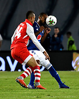BOGOTÁ - COLOMBIA, 28–03-2019: Luis Payares de Millonarios disputa el balón con Brayan Perea de Independiente Santa Fe, durante partido aplazado de la fecha 10 entre Millonarios y el Independiente Santa Fe, por la Liga Águila I 2019, jugado en el estadio Nemesio Camacho El Campín de la ciudad de Bogotá. / Luis Payares of Millonarios vies for the ball with Brayan Perea of Independiente Santa Fe, during a posponed match of the 10th date between Millonarios and Independiente Santa Fe, for the Aguila Leguaje I 2019 played at the Nemesio Camacho El Campin Stadium in Bogota city, Photo: VizzorImage / Luis Ramírez / Staff.
