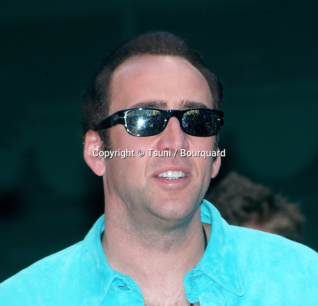 """Nicolas Cage star of the next John Woo movie """"Windtalkers"""" went to the ceremonie honoring John Woo with hand and footprint in the courtyard of  The Chinese Theatre in Los Angeles. May 21, 2002."""