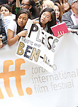 Benedict Cumberbatch fans attending the Red Carpet Arrivals for 'The Imitation Game' at the Princess of Whales Theatre during the 2014 Toronto International Film Festival on September 9, 2014 in Toronto, Canada.