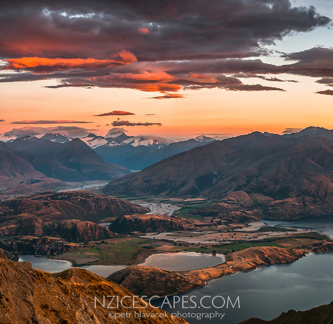 Glendhu Bay at Lake Wanaka as seen from Mt. Roy 1578m at sunrise with Mount Aspiring, Tititea 3033m in background, Mount Aspiring National Park, UNESCO World Heritage Area, Central Otago, New Zealand, NZ
