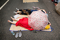 Hong Kong, Government Offices, 2 October 2014<br /> <br /> Students and other supporters of the Occupy Central movement congregating around the government offices area at Tamar. All the roads in the area are blocked from traffic and public transport. Many students and activists spent a fourth night sleeping on the street.<br /> <br /> Photo Kees Metselaar