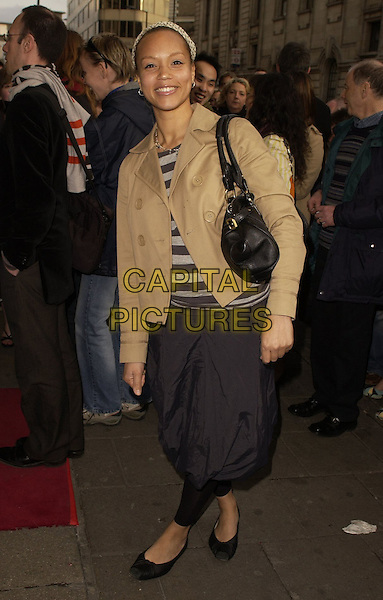 "ANGELA GRIFFIN.Outside arrivals for ""Movin' Out"" Opening Night, .Apollo Victoria Theatre, London, England, .April 10th 2006..half length tulip black skirt leggings pantaloons .Ref: CAN.www.capitalpictures.com.sales@capitalpictures.com.©Can Nguyen/Capital Pictures"