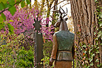 "Sculpture by Liz Wall called ""Standing Watch"" in the garden of the Manitou Galleries on Canyon Road in Santa Fe, New Mexico"