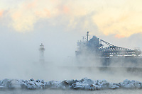 After discharging salt at the North American Salt Dock in the Duluth Harbor, the Algoway disappeared into the abundant sea smoke on Lake Superior. With the ambient air temps around -15°F (-26°C) this morning, the lake is rapidly cooling and making ice. (Fingers and toes cooled rapidly too!)