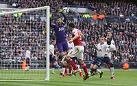 Arsenal's Sokratis Papastathopoulos with a header towards goal as Tottenham Hotspur's Hugo Lloris looks on<br /> <br /> Photographer Rob Newell/CameraSport<br /> <br /> The Premier League - Tottenham Hotspur v Arsenal - Saturday 2nd March 2019 - Wembley Stadium - London<br /> <br /> World Copyright © 2019 CameraSport. All rights reserved. 43 Linden Ave. Countesthorpe. Leicester. England. LE8 5PG - Tel: +44 (0) 116 277 4147 - admin@camerasport.com - www.camerasport.com