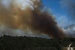 Firefighters work at the site of a wildfire in Cualedro, near Ourense on August 24, 2013. (c) Pedro ARMESTRE.