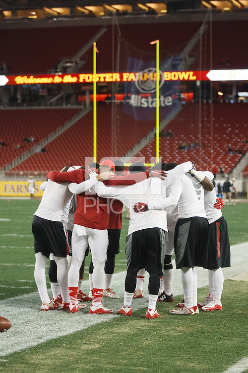 Santa Clara- December 30, 2014: Team huddle during warm ups before the Stanford vs Maryland Foster Farms Bowl at Levi's Stadium in Santa Clara Tuesday night.<br /> <br /> Stanford won 45-21.