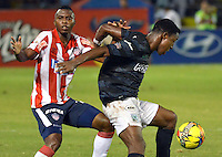 BARRANQUIILLA -COLOMBIA-18-05-2014.Maicol Balanta  (Izq) de Atletico Junior disputa el balon   con Ocar Murillo del Atletico Nacional durante partido valido por la final de la Liga Postob—n 2014-1 jugado en el estadio Metropolitano Roberto Melendez de la ciudad de Barranquilla./  Maicol Balanta  (L) of Atletico Junior dispute the ball with Atletico Nacional Oscar Murillo the earned during the final match of the 2014-1 League Postob—n played in Metropolitan Stadium Roberto Melendez in Barranquilla.  Photo: VizzorImage / Alfonso Cervantes / STR.