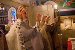Liturgy service at St. Sava Orthodox Church, Jackson, Calif...Very Reverend Stavrofor Miladin Garich, Father Stephen Tumbas with their arms above the altar during the worship service.