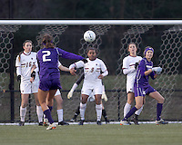 "University of Washington midfielder Kate Deines (2) direct kick into Boston College wall. In overtime, Boston College defeated University of Washington, 1-0, in NCAA tournament ""Elite 8"" match at Newton Soccer Field, Newton, MA, on November 27, 2010."