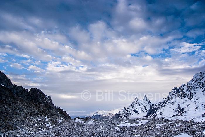 Granite mountain spires with snow on the Biafo glacier in the Karakoram himalaya mountains of Pakistan