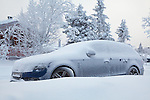 Audi A4 covered with snow at Venabygdsfjell in the Norwegian mountains close to Lillehammer
