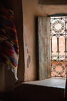 Morocco.  Window Grill in a House in the Ait Benhaddou Ksar, a World Heritage Site.