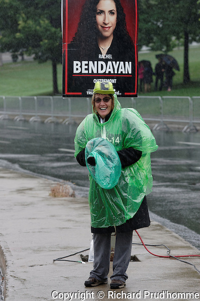 Press photographer Lise Deschenes covering the Grand Prix Cyclists event  in Montreal  held on a rainy Sunday