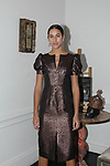 Carla poses in a bronze puff sleeve slim dress from the Barbara Tfank Fall Winter 2019 collection on February 13, 2019 at The Elizabeth Collective during New York Fashion Week.