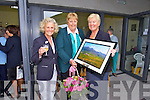 Mary McKenna is presented with a picture of Castlegregory Golf Course at the official opening of the new club house on Saturday pictured Nora Keogan, Lady Captain Castlegregory Golf Club, Mary McKenna, President of the Irish Ladies Golf Union, Marion Bourke, Lady President Castlegregory Golf Club