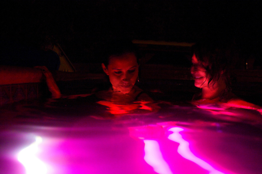 Los Angeles, California, August 1, 2009 - Warpaint guitarist/keyboardist, Theresa Wayman and guitarist, Emily Kokal enjoy the pool of Moonrats guitarist, Nathan Thelen's home in the hills above Studio City. The two bands just finished a 10-day tour of the west coast and ended the tour with a relaxing night of swimming. .
