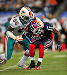 7 December 2008: Buffalo Bills' wide receiver Roscoe Parrish is tackled on a kickoff return by Miami Dolphins linebacker Charlie Anderson during the first regular season NFL game ever played in Canada. The Dolphins defeated the Bills 16-3 at the Rogers Centre in Toronto, Ontario. ..Mandatory Photo Credit: Ed Wolfstein Photo