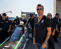 Sep 6, 2015; Clermont, IN, USA; Television personality Richard Rawlings stands alongside the Gas Monkey sponsored dragster of NHRA top fuel driver Kebin Kinsley during qualifying for the US Nationals at Lucas Oil Raceway. Mandatory Credit: Mark J. Rebilas-USA TODAY Sports