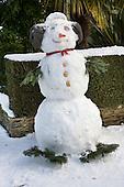 Snowmman in a suburban street, London.