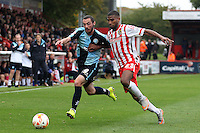 Michael Harriman of Wycombe Wanderers and Jerome Okimo of Stevenage in action during the Sky Bet League 2 match between Stevenage and Wycombe Wanderers at the Lamex Stadium, Stevenage, England on 17 October 2015. Photo by PRiME Media Images.