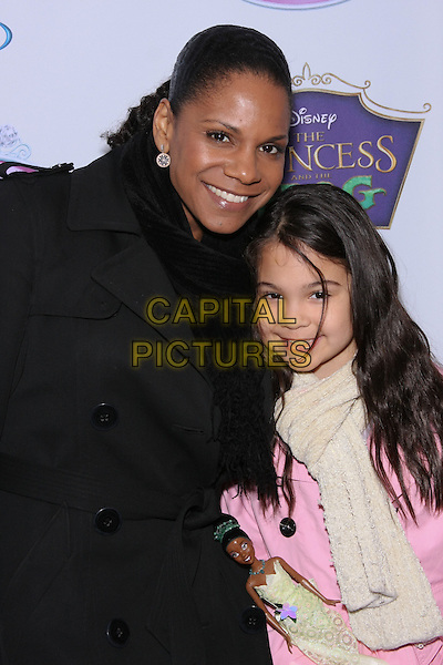 AUDRA McDONALD & ZOE (daughter).The Crowning event for Princess Tiana joining the Royal Court of Disney Princesses held at the Palace Hotel, New York, NY, USA.                                                                           .March 14th, 2010.half length coat jacket pink white mother mum mom black scarf .CAP/LNC/TOM.©TOM/LNC/Capital Pictures.
