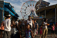 Coney Island, New York City, NY, 5 July 2014. Highlights from a summer day in Coney Island In New York. The neighborhood that features an amusement area that includes around 50 attractions by Photo by Joana Toro VIEWpress.