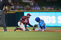 Frisco RoughRiders second baseman Yonny Hernandez (54) tags Luis Torrens (21) sliding in during a Texas League game against the Amarillo Sod Poodles on July 12, 2019 at Dr Pepper Ballpark in Frisco, Texas.  (Mike Augustin/Four Seam Images)