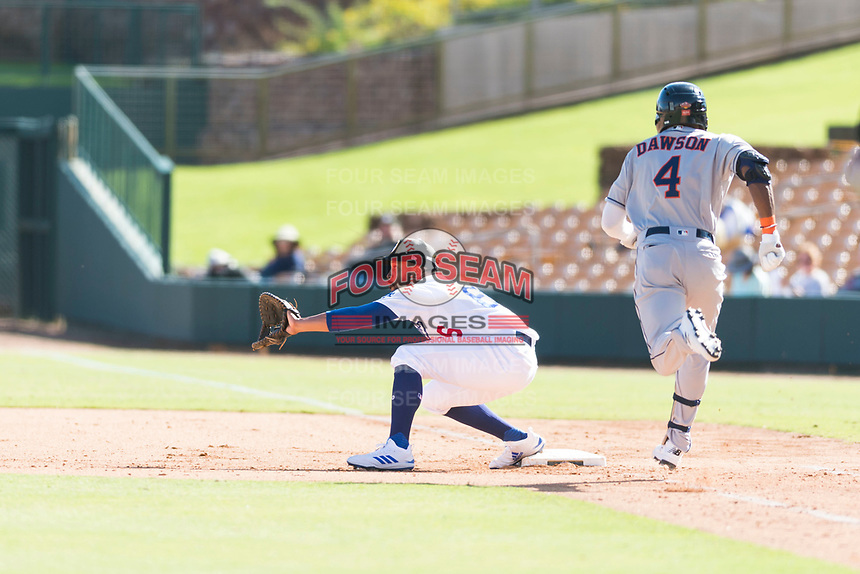 Glendale Desert Dogs first baseman Jared Walker (66), of the Los Angeles Dodgers organization, waits to receive a throw as Ronnie Dawson (4), of the Houston Astros organization, runs up the first base line during an Arizona Fall League game against the Scottsdale Scorpions at Camelback Ranch on October 16, 2018 in Glendale, Arizona. Scottsdale defeated Glendale 6-1. (Zachary Lucy/Four Seam Images)