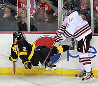 Nebraska-Omaha's Michael Young sends Colorado College's William Rapuzzi to the ice. Colorado College defeated Nebraska-Omaha 5-2 Saturday night at CenturyLink Center in Omaha. (Photo by Michelle Bishop) .