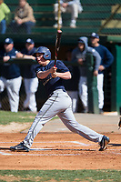 Zach Little (15) of the Wingate Bulldogs follows through on his swing against the Catawba Indians at Newman Park on March 19, 2017 in Salisbury, North Carolina. The Indians defeated the Bulldogs 12-6. (Brian Westerholt/Four Seam Images)