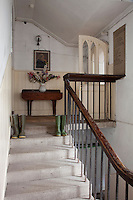 A staircase in the servants' wing where a call bell still hanging on the wall