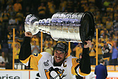 June 11th 2017, Nashville, TN, USA;  Pittsburgh Penguins center Sidney Crosby (87) is shown with the Stanley Cup following Game 6 of the Stanley Cup Final between the Nashville Predators and the Pittsburgh Penguins, held on June 11, 2017, at Bridgestone Arena in Nashville, Tennessee.