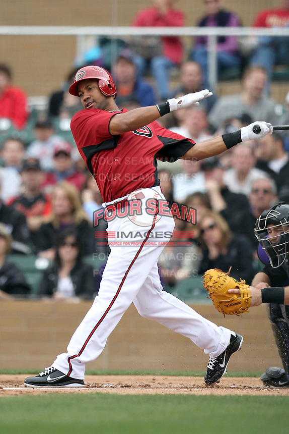 Chris Young #24 of the Arizona Diamondbacks plays against the Colorado Rockies in the inaugural spring training game at Salt River Fields on February 26, 2011 in Scottsdale, Arizona. .Photo by:  Bill Mitchell/Four Seam Images.