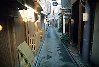 "The geisha district in downtown Kyoto is a place of mystery and money. One sign reads ""Jazz & Whiskey."""
