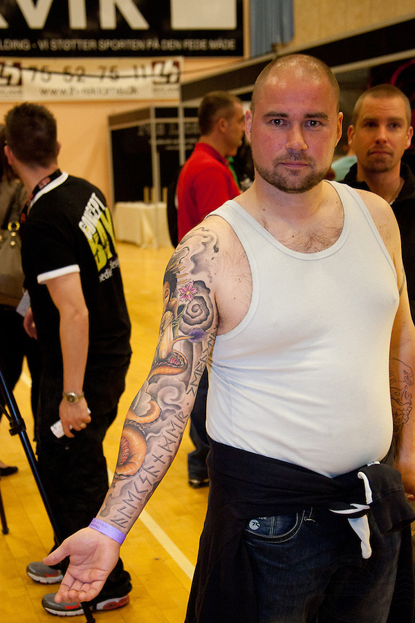 Tattoo Convention in Kolding 2011. Arranged by BodyMod.dk<br /> Man with full sleeve. Beautiful japanese geisha on shoulder. Runes on inside of arm.