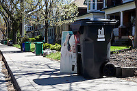 A portrait of Pope John Paul II on garbage day in Toronto