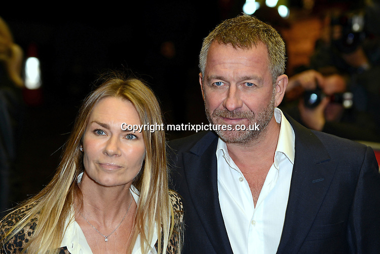 NON EXCLUSIVE PICTURE: MATRIXPICTURES.CO.UK<br /> PLEASE CREDIT ALL USES<br /> <br /> WORLD RIGHTS<br /> <br /> English actor Sean Pertwee and his wife, Jacqui Hamilton-Smith attending the UK premiere of Dom Hemingway, at The Curzon Mayfair in London. <br /> <br /> OCTOBER 28th 2013<br /> <br /> REF: SLI 137031