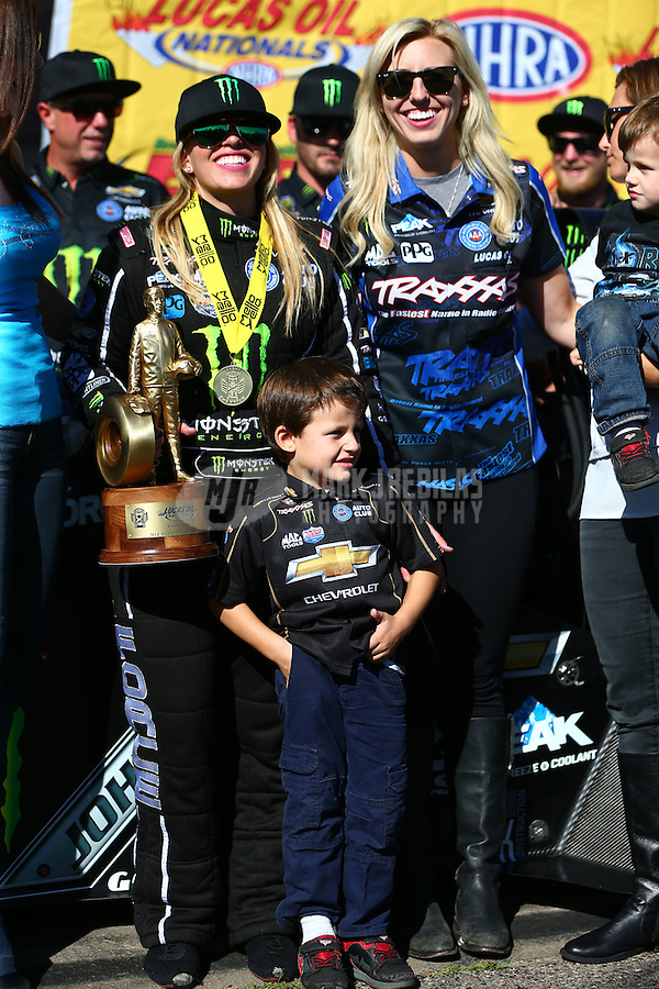 Aug 21, 2016; Brainerd, MN, USA; NHRA top fuel driver Brittany Force (left) celebrates with sister Courtney Force after winning the Lucas Oil Nationals at Brainerd International Raceway. Mandatory Credit: Mark J. Rebilas-USA TODAY Sports