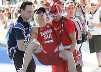 03 SEP 2006 - LAUSANNE, SWITZERLAND - Switzerlands Charles Rusterholz is helped from the finish line after finishing in the Mens u23 World Triathlon Championships. (PHOTO (C) NIGEL FARROW)