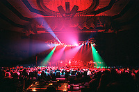 "The Grateful Dead performing their New Years Concerts Run at the San Francisco Civic Auditorium, 28 December 1984 into 1 January 1985. This is from the second night, a typical ""Lighting Look"" Shot. Shot on Color Negative Film, Kodak CM135-36."