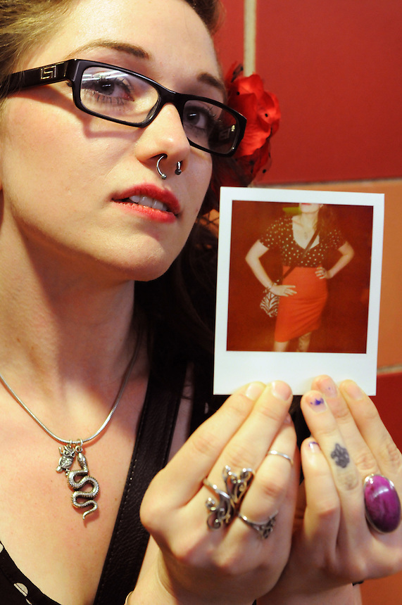 Heather Juergens of Seattle holds a Polaroid photo depicting the polka dot dress she wore to the 2011 Bumbershoot music and arts festival in Seattle Center on Monday, September 5, 2011. Juergens said her fashion is inspired by 1950s-era pin-up art.