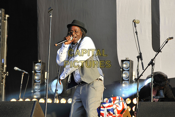 Neville Staple of The Specials .performing at BT London Live Closing Ceremony Celebration Concert, Hyde Park London, England. .12th August 2012.on stage in concert live gig performance half length black hat white shirt grey gray waistcoat hand arm singing glasses.CAP/MAR.© Martin Harris/Capital Pictures.
