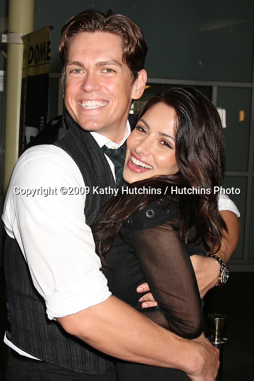 Steve Harvey & Sarah Shahi.arriving at the Stan Helsing Premiere.ArcLight Theater.Los Angeles,  CA.October 20, 2009.©2009 Kathy Hutchins / Hutchins Photo.